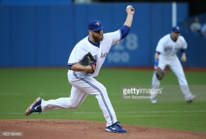 TORONTO, CANADA - AUGUST 6: Mark Buehrle #56 of the Toronto Blue Jays delivers a pitch in the first inning during MLB game action against the Minnesota Twins on August 6, 2015 at Rogers Centre in Toronto, Ontario, Canada. (Photo by Tom Szczerbowski/Getty Images) *** Local Caption *** Mark Buehrle