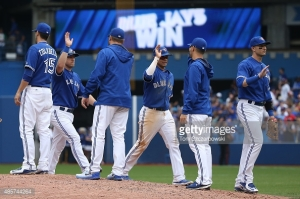 TORONTO, CANADA - AUGUST 29: Ryan Goins #17 of the Toronto Blue Jays celebrates their victory with Marco Estrada #25 during MLB game action against the Detroit Tigers on August 29, 2015 at Rogers Centre in Toronto, Ontario, Canada. (Photo by Tom Szczerbowski/Getty Images) *** Local Caption *** Ryan Goins; Marco Estrada